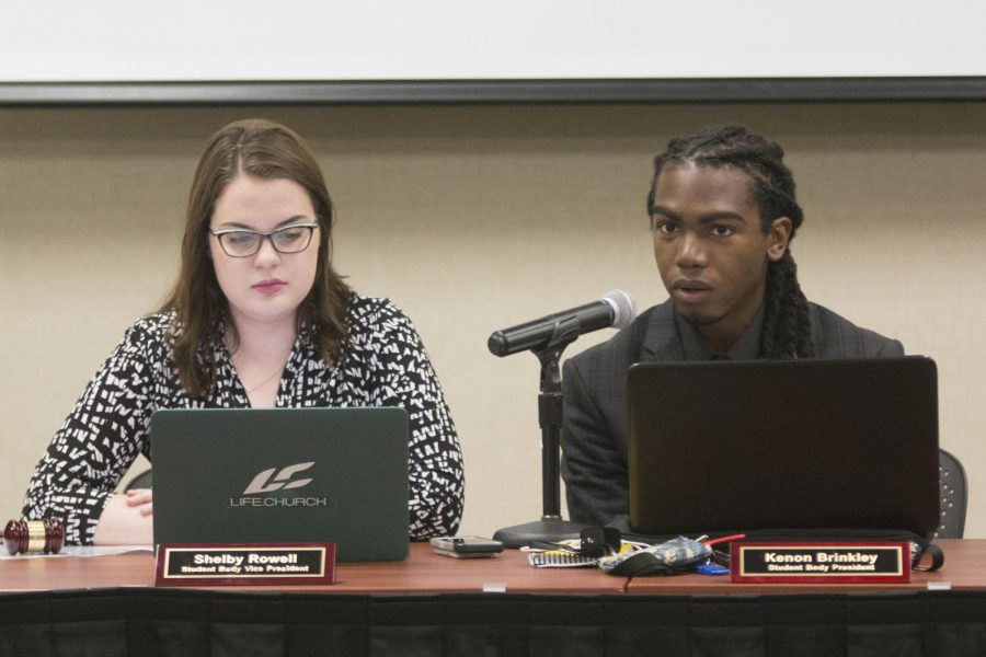 Kenon Brinkley answers questions alongside Shelby Rowell during a Student Senate meeting last September. Brinkley resigned as student body president Wednesday, and will be replaced by Rowell.