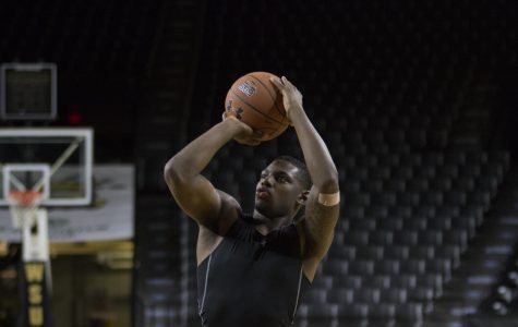 Freshman guard Jamarius Burton practices in Koch Arena Tuesday, Sept. 11, 2018.