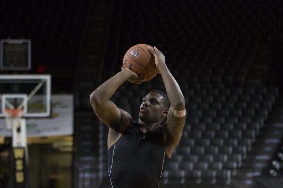 Freshman guard Jamarius Burton practices in Koch Arena Tuesday, Sept. 11, 2018.