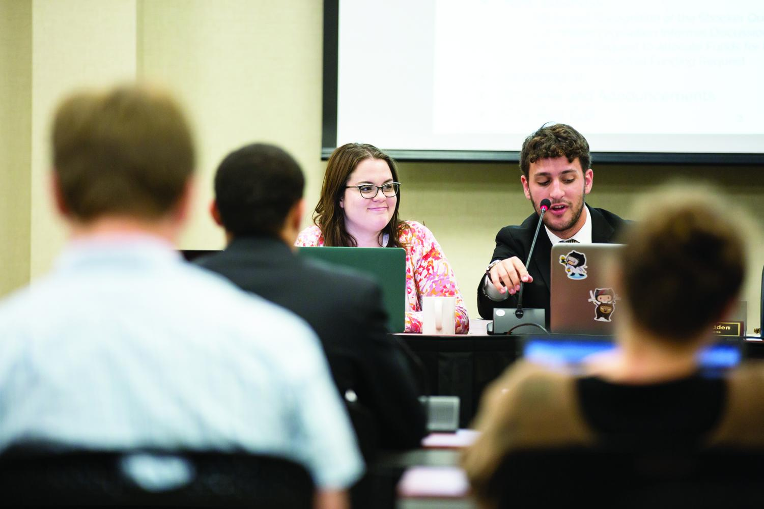 Student Body Vice President Shelby Rowell (left) and Chief of Operations Matthew Madden lead a Student Government meeting Wednesday evening. The Student Senate voted unanimously to allocate around $2,600 to buy three new laptops.