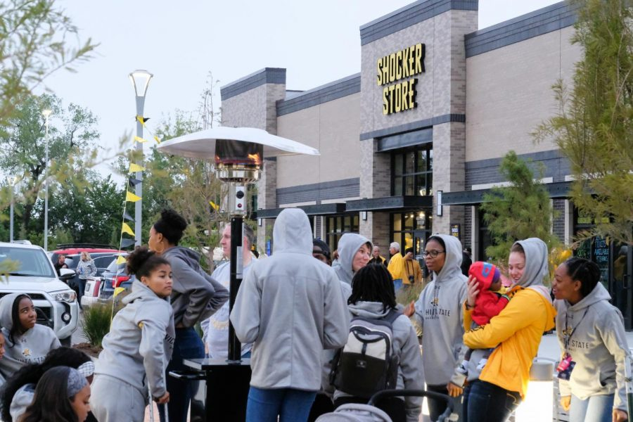 Wichita State students attend the grand opening of the Shocker Store in Braeburn Square, on Friday, Sep. 28, 2018.