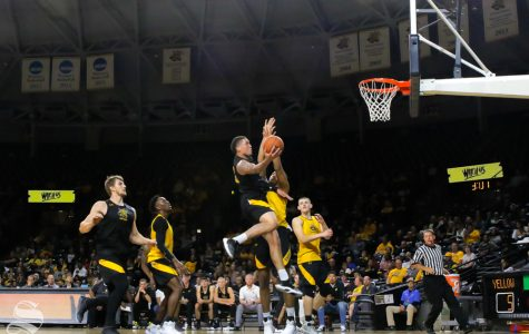 Wichita State's Teddy Allen goes up for a basket during the Black and Yellow Scrimmage at Koch Arena on Oct. 6, 2018.