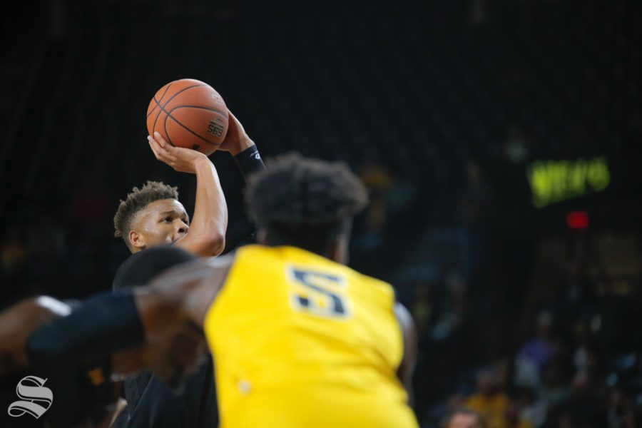 Wichita+State%27s+Dexter+Dennis+shoots+a+free+throw+during+their+scrimmage.+The+Shockers+participated+in+the+Black+and+Yellow+Scrimmage+at+Koch+Arena+on+Oct.+6%2C+2018.