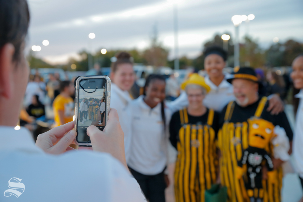 Wichita State fan's take pictures with Women's Basketball players on Monday at the pep rally. (Joseph Barringhaus/The Sunflower)
