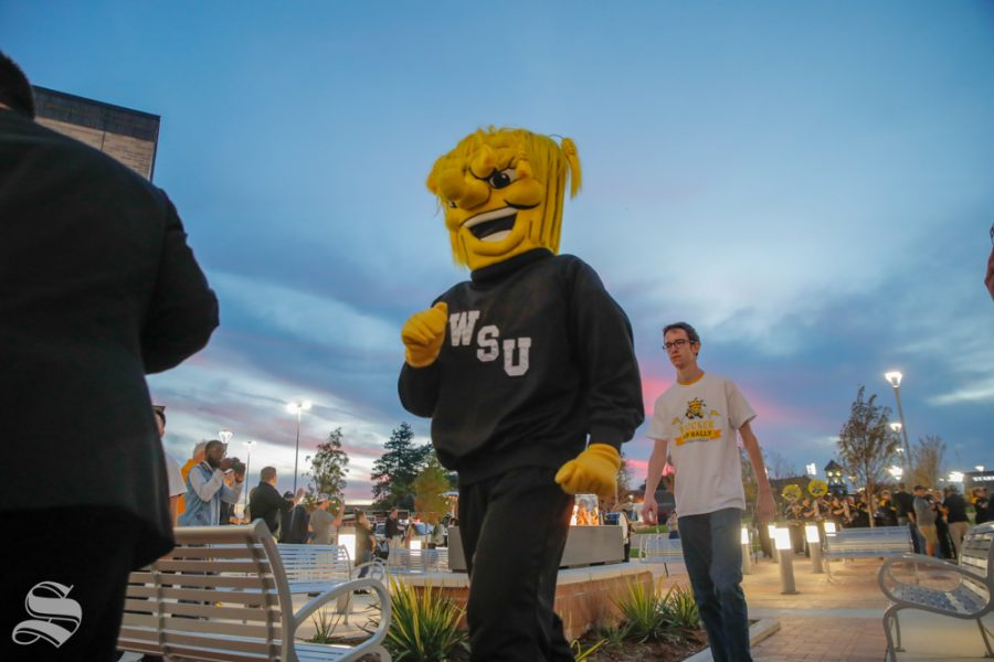 Wu+Shock+walks+into+the+pep+rally+with+the+Shocker+Marching+Band+at+the+pep+rally+on+Monday.+%28Joseph+Barringhaus%2FThe+Sunflower%29