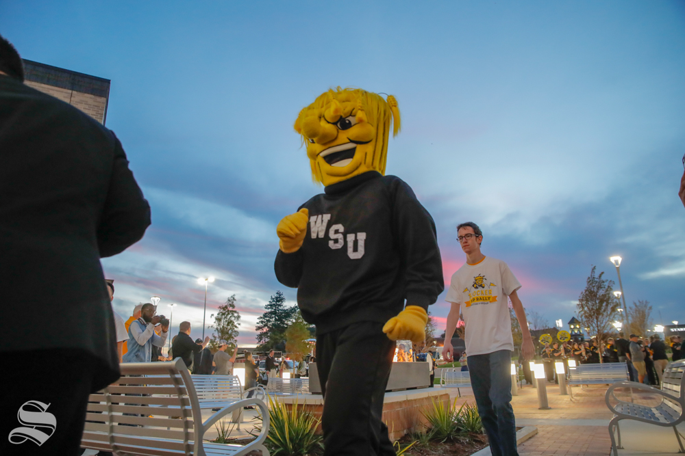 Wu Shock walks into the pep rally with the Shocker Marching Band at the pep rally on Monday. (Joseph Barringhaus/The Sunflower)