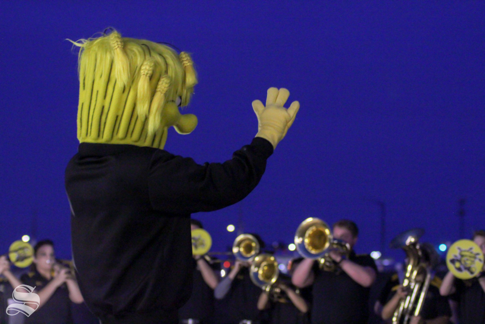 Wu Shock conducts the Shocker Sound band at the pep rally. (Kylie Cameron/The Sunflower)