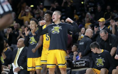 Wichita State's Erik Stevenson cheers on his teammates during their game against Catawba on Oct. 30, 2018 at Koch Arena.