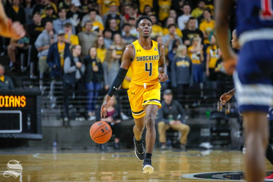 Wichita+State%27s+Samajae+Haynes-Jones+dribbles+down+the+court+during+their+game+against+Catawba+on+Oct.+30%2C+2018+at+Koch+Arena.