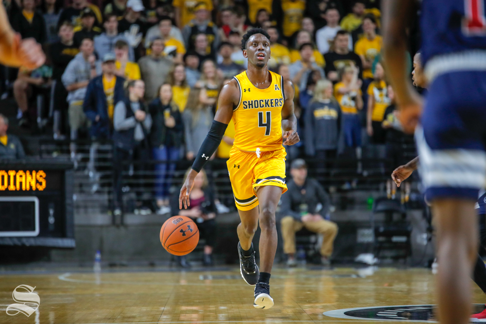 Wichita State's Samajae Haynes-Jones dribbles down the court during their game against Catawba on Oct. 30, 2018 at Koch Arena.