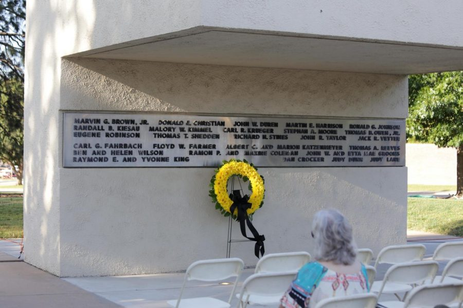 A wreath is placed on Football Memorial '70. Family members of those who died in the plane crash on Oct. 2, 1970, place a wreath on the memorial each year to memorialize the 31 lives lost in the crash.