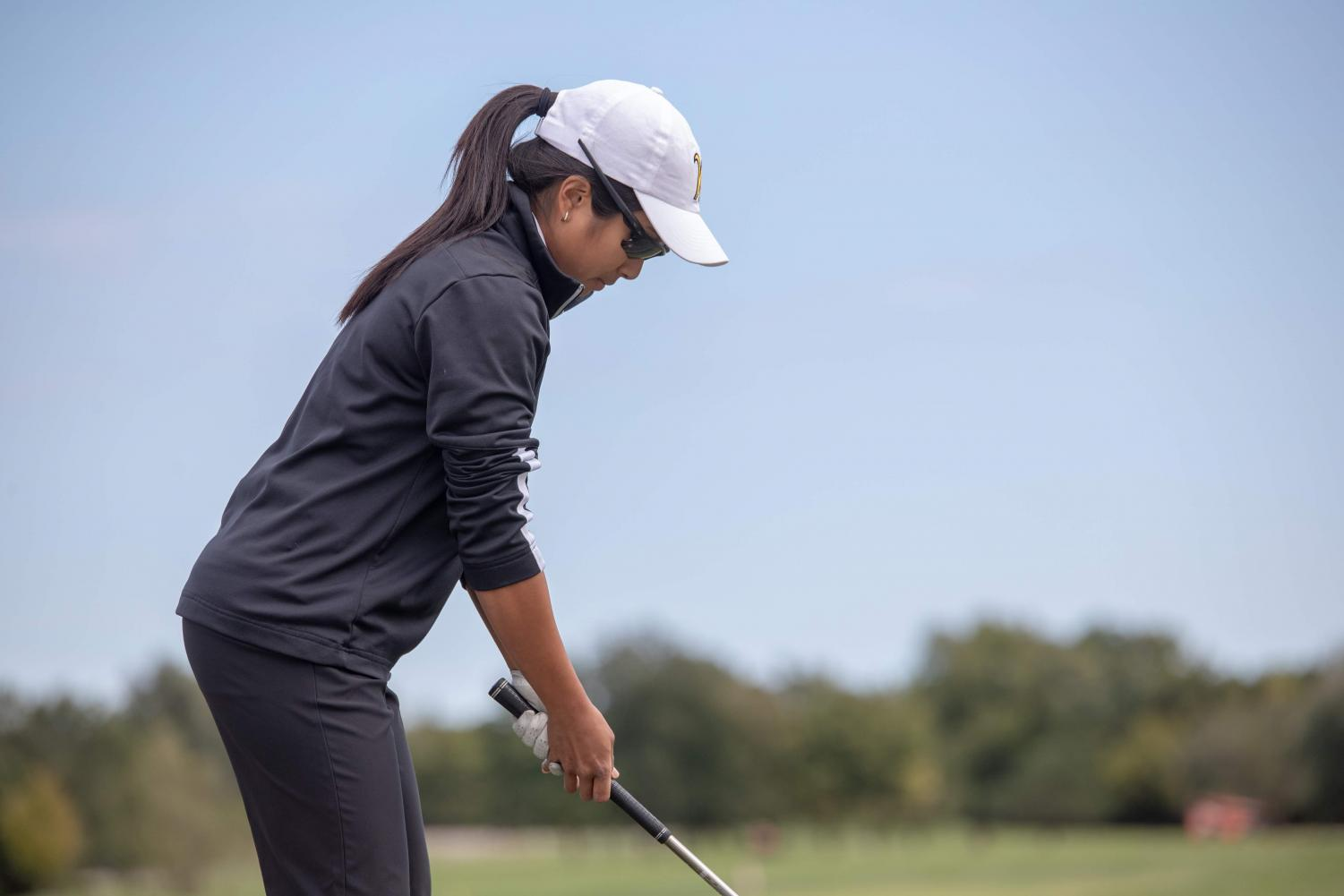 Wichita State's Gavrilla Arya lines up for a shot on the course during practice on Oct. 11, 2018.