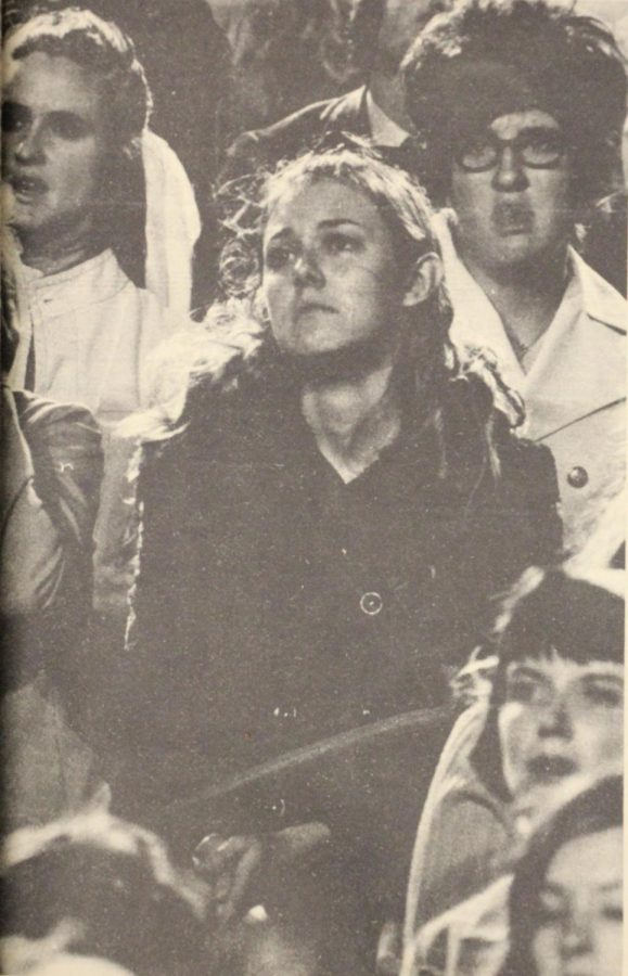 Where have all the flowers gone? The tear-filed eyes of this young lady at Memorial services for those killed in last week's tragedy express the shock and emotion felt by much of the Wichita community. More than 12,000 people came to Cessna Stadium Monday night to pay tribute to those who died. Oct. 9, 1970.