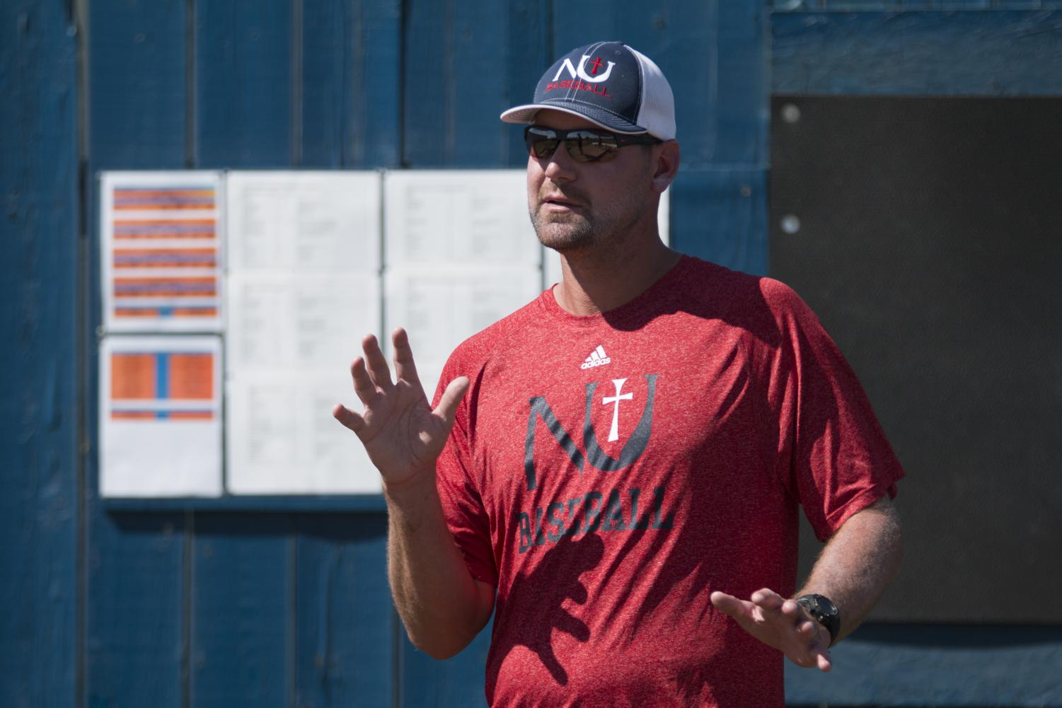 Newman University Pitching Coach Mike Pelfrey instructs pitchers during practice. Pelfrey was a pitcher for Wichita State until he was drafted after his junior year in 2005.