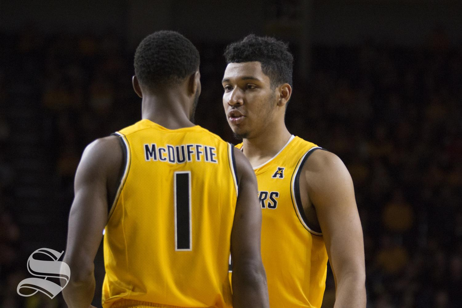 Wichita State's Jaime Echenique  (21) speaks to Markis McDuffie (1) during the exhibition game against Catawba Oct. 29, 2018.