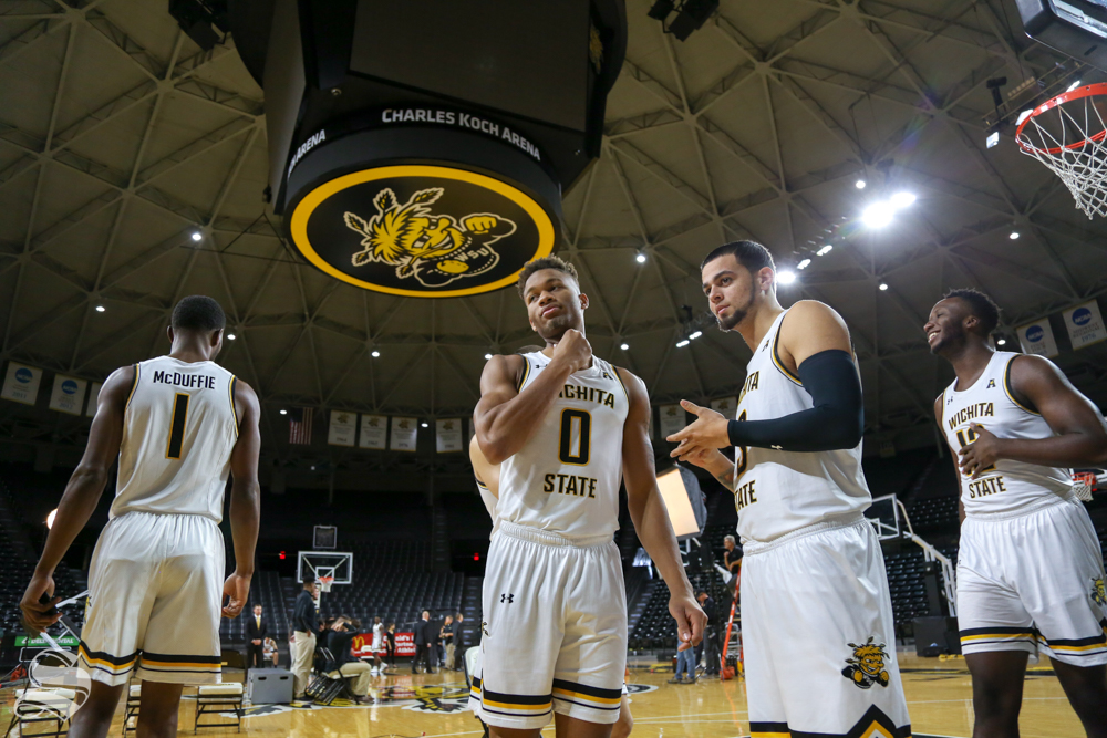 McDuffie, Dennis, Torres, and Udeze hang out during media day at Koch Arena.
