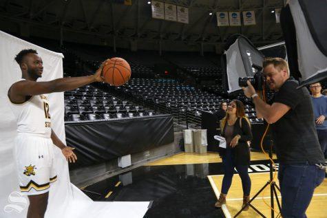 The Sunflower's Joseph Barringhaus photographs Morris Udeze during media day at Koch Arena in 2018.