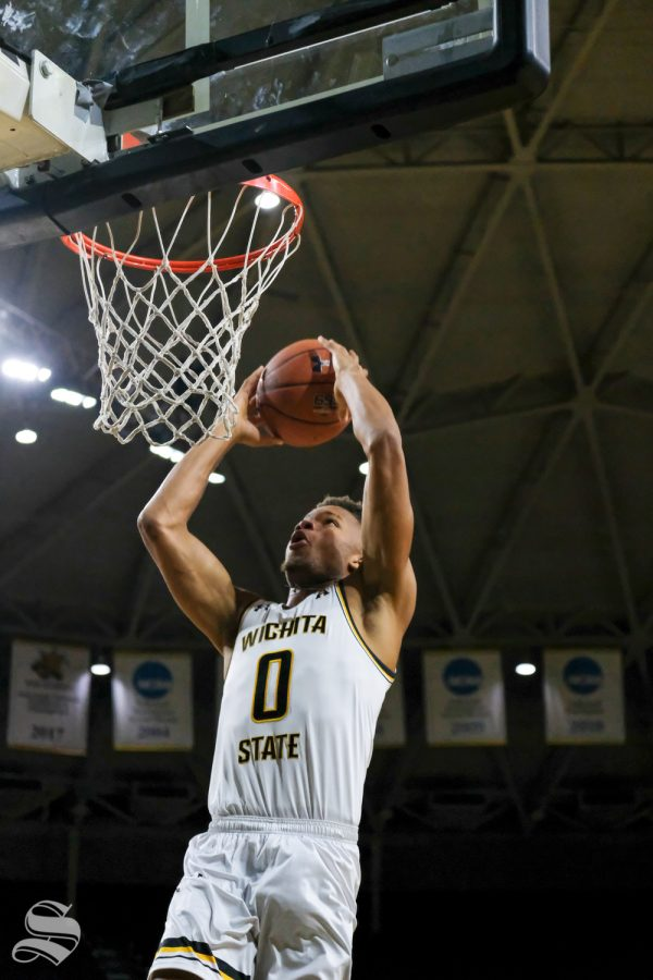 Wichita State guard Dexter Dennis dunks the ball during a break at media day on Oct. 16, 2018.