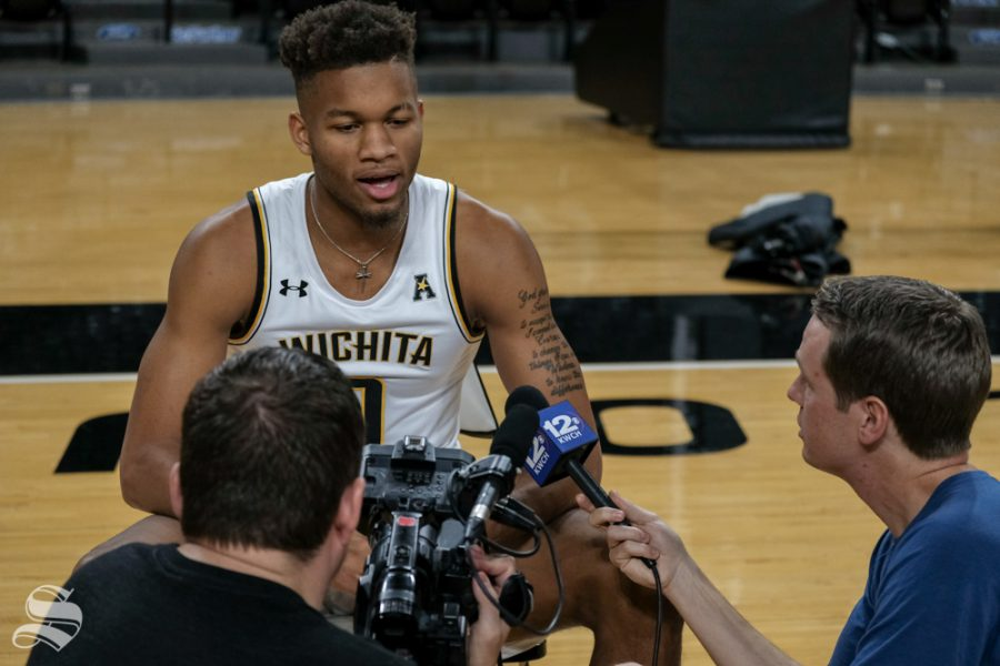 Wichita+State+guard+Dexter+Dennis+has+an+interview+with+the+reporter+from+KWCH+12+at+media+day+on+Oct.+16%2C+2018.