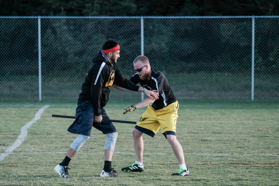 Eric Cruz (right), a chaser, try to take the snitch tail from Davey Kiker (left) who is the snitch.