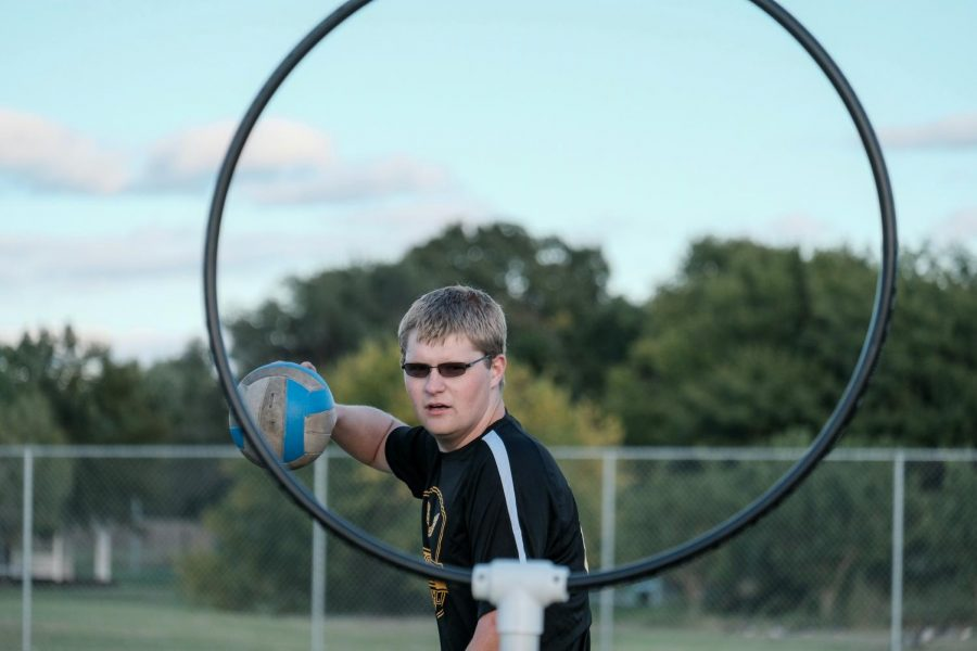 Damon Penner, a sophomore majoring in History, is the vice president of Wichita State Quidditch. He scores by throwing the quaffle ball through the hoop.