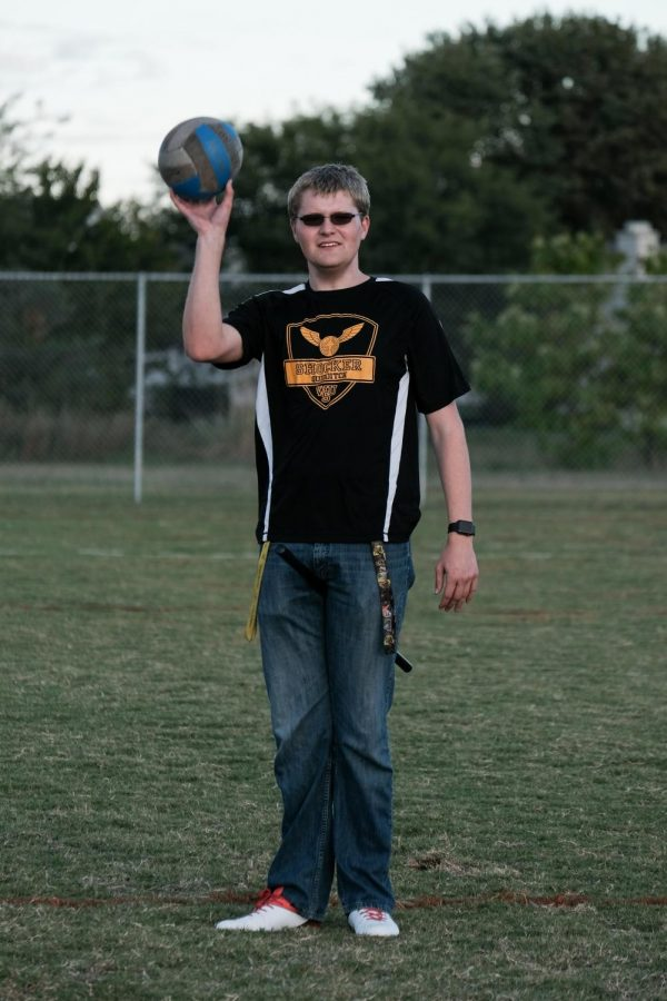 A sophomore majoring in History, Damon Penner, is the vice president of Wichita State Quidditch. He passes the quaffle ball in practice.