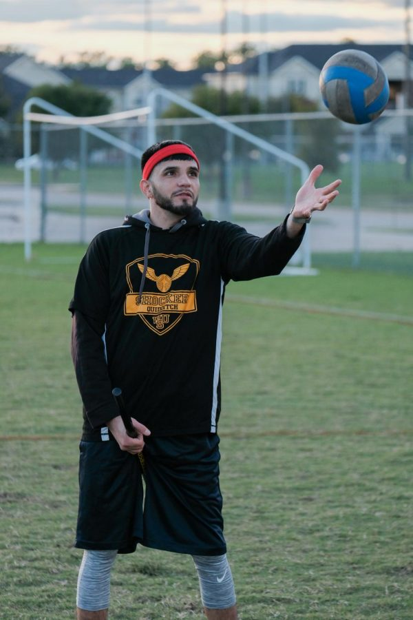 Eric Cruz plays as beater and chaser for Wichita State Quidditch team. He catches the quaffle ball.