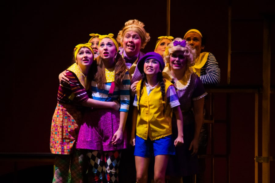 Courtney Wages sings with cast members at Suessical, the musical.