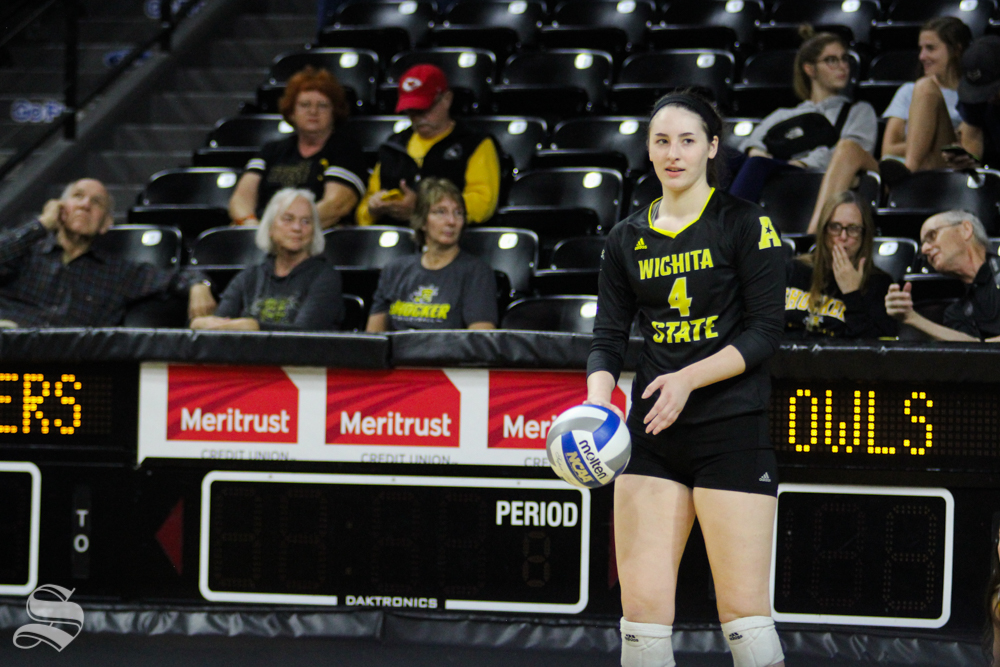 Wichita State's Kora Kauling readys herself for a serve at their game against Temple on Oct. 28 at Koch Arena.