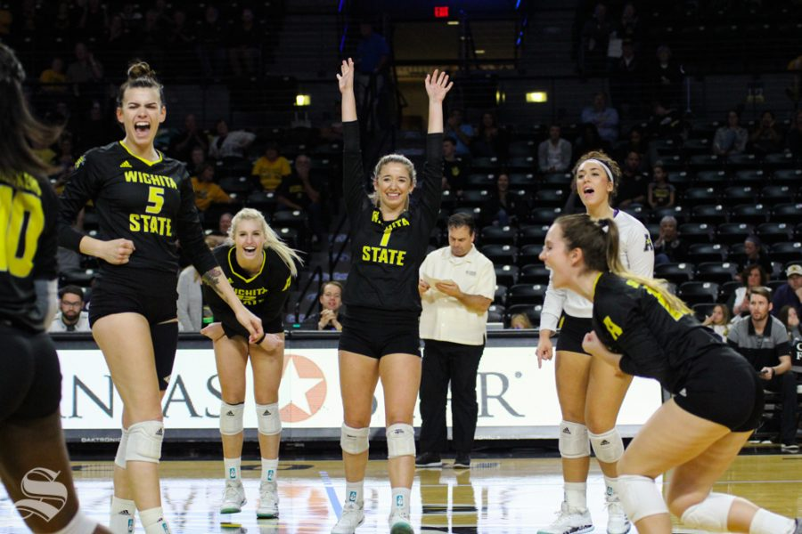 Wichita State players celebrate after a point by Tabitha Brown at their game against Temple on Oct. 28 at Koch Arena.