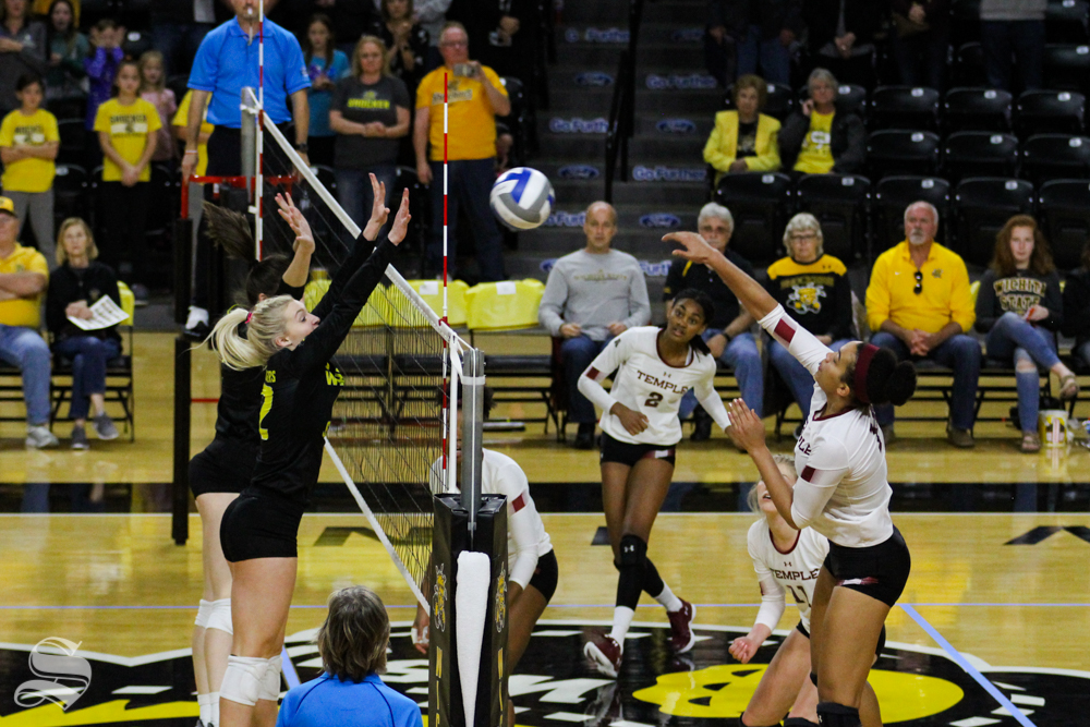 Wichita State's Regan Stiawalt and Grace Burken double block an attack from Temple's Dana Westfield at their game on Oct. 28 in Koch Arena.