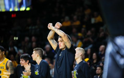 Wichita State's Teddy Allen cheers on his teammates during their game against Catawba on Oct. 30, 2018 at Koch Arena.