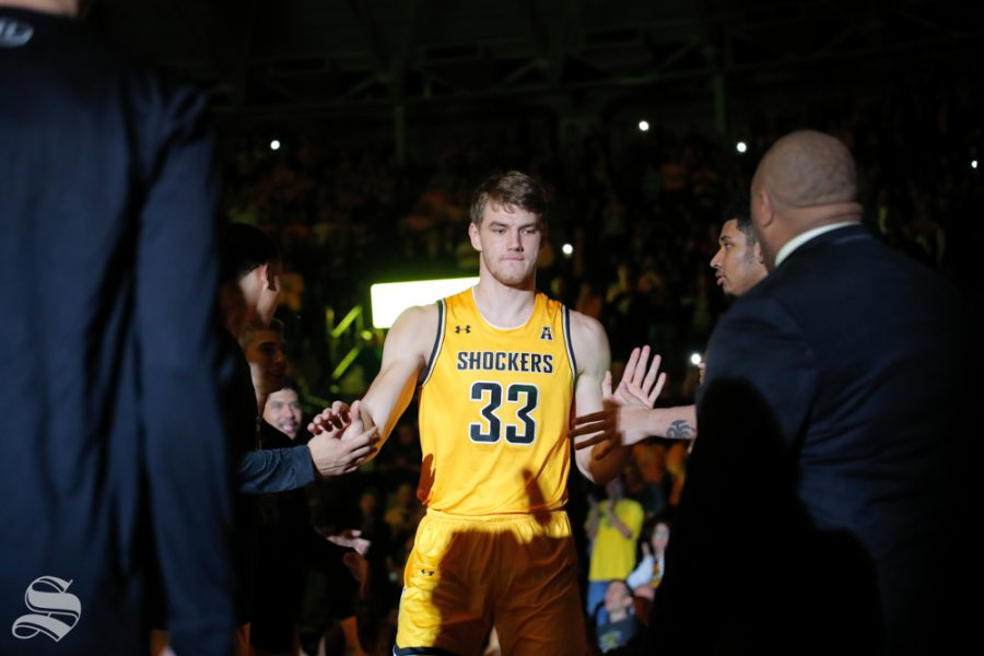 Wichita+State%27s+Asbj%C3%B8rn+Midtgaard+walks+onto+the+court+at+the+start+of+their+game+against+Catawba+on+Oct.+30%2C+2018.