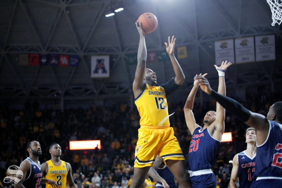 Wichita States Morris Udeze goes up for a basket during their game against Catawba on Oct. 30, 2018 at Koch Arena.
