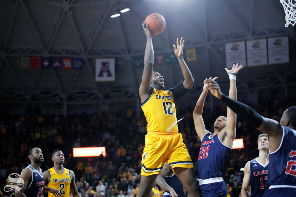 Wichita State's Morris Udeze goes up for a basket during their game against Catawba on Oct. 30, 2018 at Koch Arena.