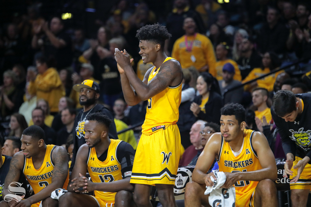 Wichita State's Rod Brown cheers on his teammates during their game against Catawba on Oct. 30, 2018 at Koch Arena.