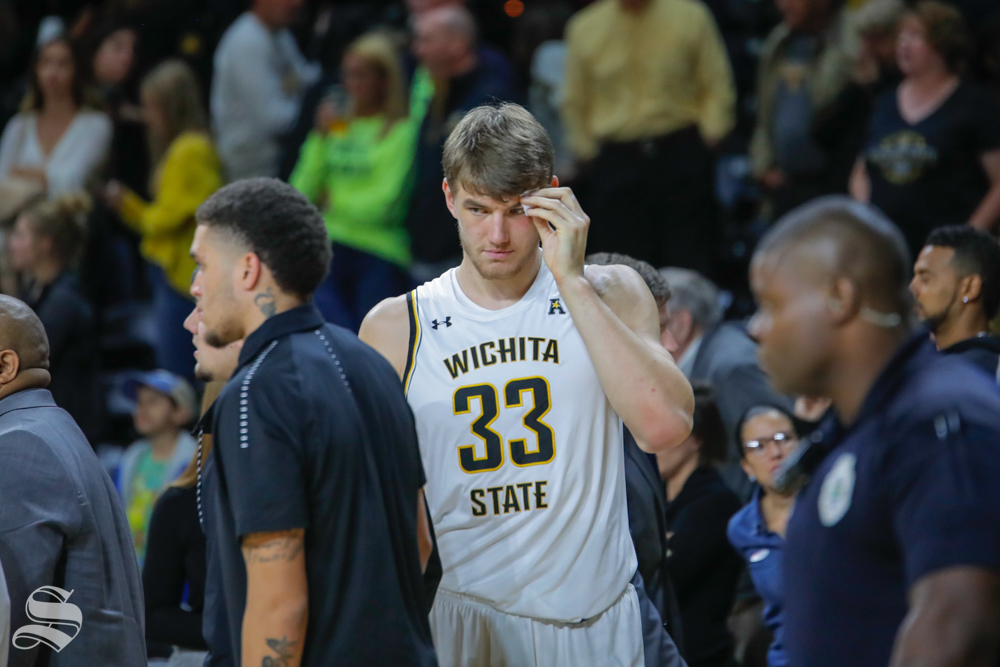 Wichita State's Asbjørn Midtgaard holds his eye after being hit during their game against Louisiana Tech in Koch Arena on Nov. 6, 2018. Midtgaard will most likely receive stiches following the game.
