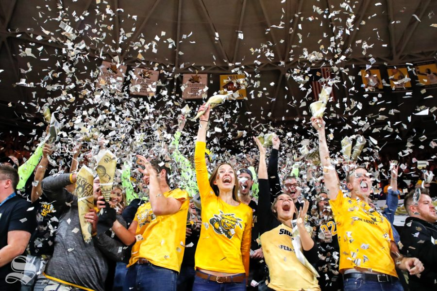 The+Wichita+State+student+section+throws+up+pieces+of+%22The+Sunflower%22+after+the+first+basket+of+the+game+on+Nov.+6%2C+2018+in+Koch+Arena.