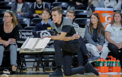 Wichita State's Assistant Coach, Austin Hosto, stares down the court after his team loses a point.