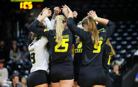 Wichita State volleyball huddles together before the start of their game on Nov. 11, 2018 against SMU.