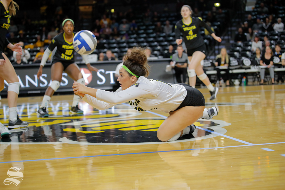 Wichita State libero Giorgia Civita dives for a ball during their game against SMU on Nov. 11, 2018 at Koch Arena.
