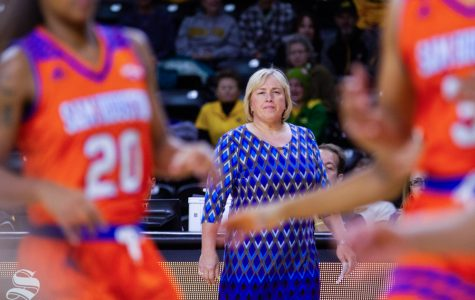 Wichita State's Head Coach Keitha Adams watches as her team moves the ball down the court at their game against Sam Houston State on November 14.