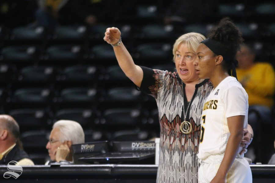 Wichita State Head Coach Keitha Adams talks to Ashley Reid on the sidelines during the season opener against Arkansas-Pine Bluff.
