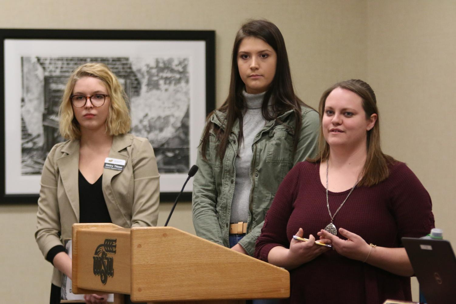 Members of the infrastructure steering committee Gentry Thiesen (left), Hannah Foster (center), and Ashley Estes (right) present during open forum of the Student Government Association meeting Wednesday, Nov. 14.
