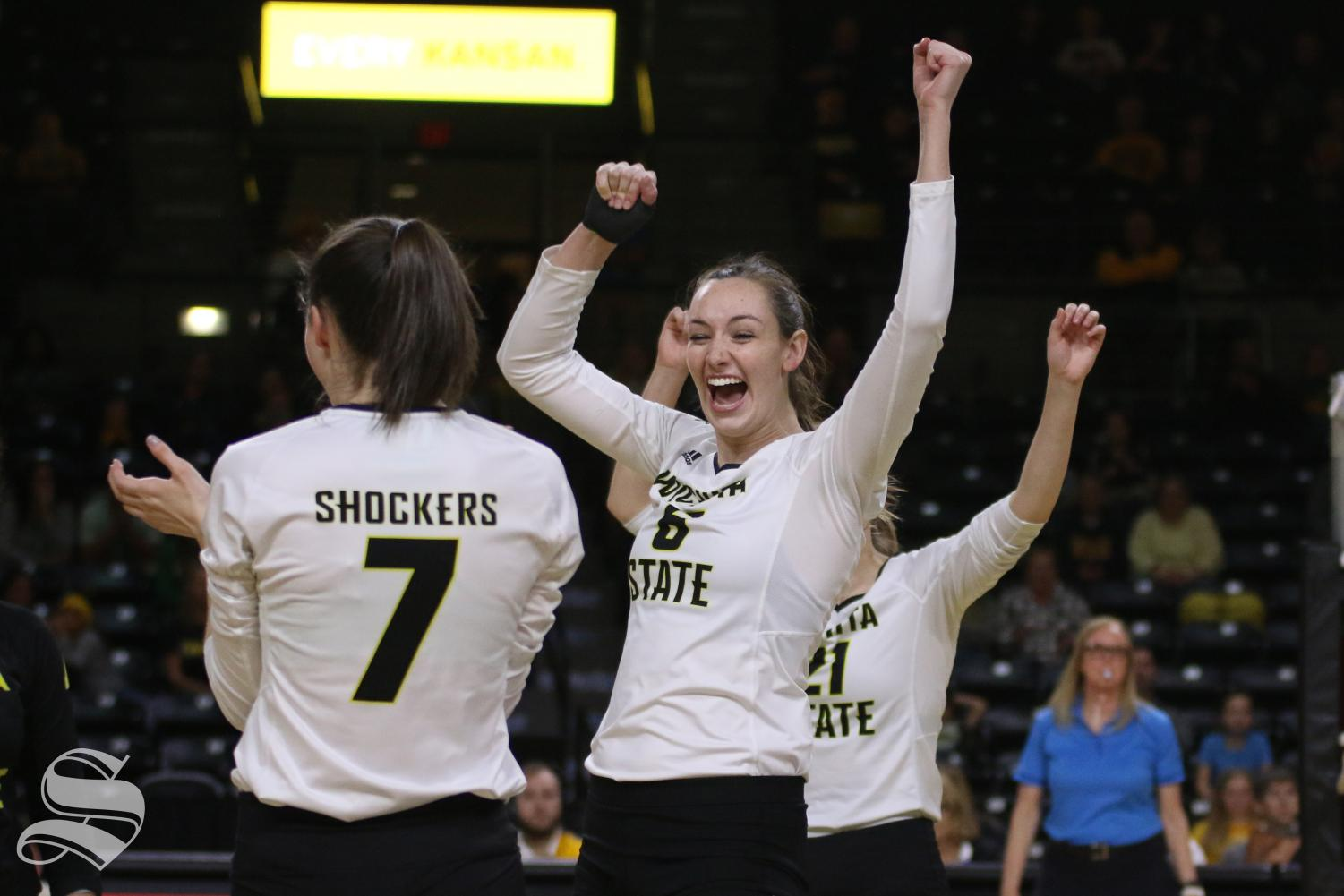 Members of Wichita State's volleyball team celebrate after scoring against North Texas last season.