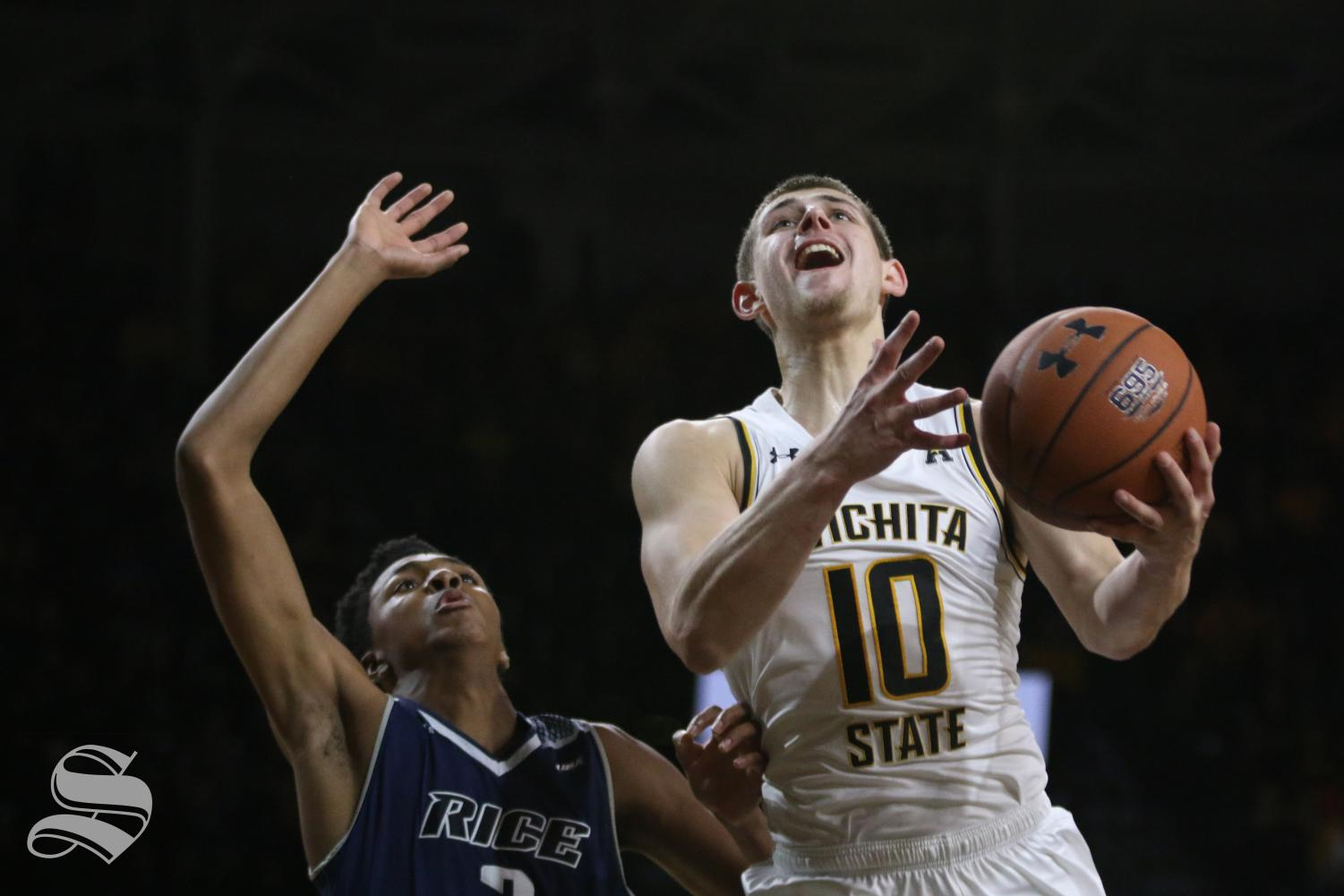 Wichita State freshman Erik Stevenson goes up for a basket during the game against Rice.