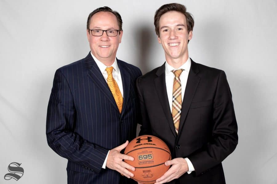 Gregg Marshall and his son, Kellen Marshall, pose together during media day on Oct. 16, 2018.