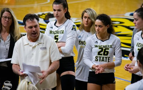 Wichita State's head coach Chris Lamb speaks to team members during their game against North Texas in Koch Arena on November 24.