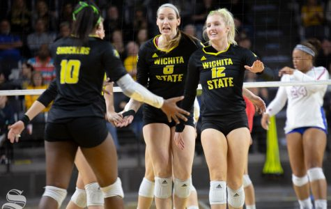Wichita State's Emma Wright (left) and Regan Stiawalt (right) celebrate. Wichita State lost to Southern Methodist in three sets Sunday at Charles Koch Arena.