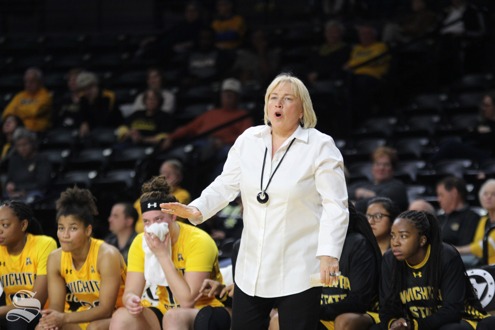 Women%27s+basketball+head+coach+Keitha+Adams+yells+out+plays+on+the+sidelines.